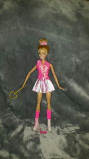 Barbie doll , she swings her arm when the string on her back is pulled. She ialso has skates.