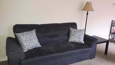 Couch / Sofa with throw pillows