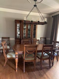 Millennial Serengeti Ashley furniture dining room set China cabinet