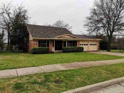 2300 Woodlawn Drive Ennis, Four BR Two BA 2- Story Home in