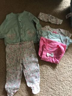 Carters 0-3 month outfit with three matching onesies and headband.