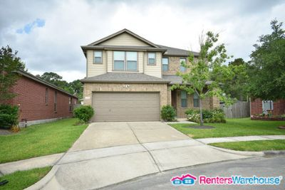 Immaculate brick home in Canyon Village At Park Lakes