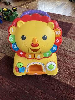 Excellent condition sit on or walk behind learning lion