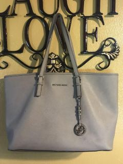 MK purse with leather cleaner included