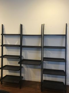 Leaning bookcase shelves