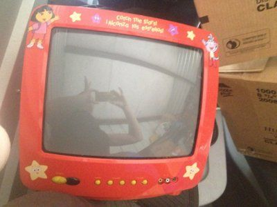 """13"""" red dora tv with remote"""