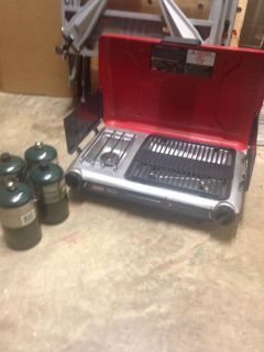 Coleman grill/stove plus 3+ bottles of propane