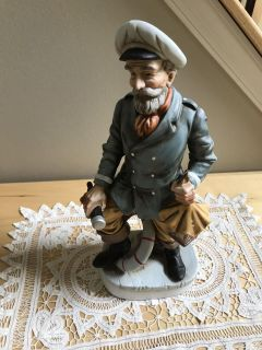 Nautical Sea Captain holding Spy Glass and Lamp. Porcelain, approx 12 tall. Exc cond!