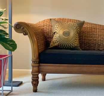 Carved Wood Sofa Chaise with Woven Rattan