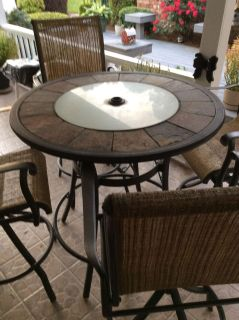 5 PIECE PATIO FURNITURE SET. BAR HEIGHT TABLE AND 4 SWIVEL CHAIRS