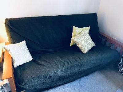 Mission style wooden futon with mattress and Ikea slipcover
