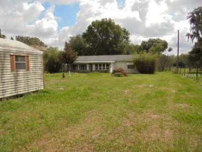 Investment property on over an acre of land in Land O Lake!