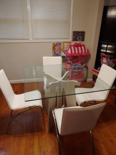 white glass table with 4 chairs