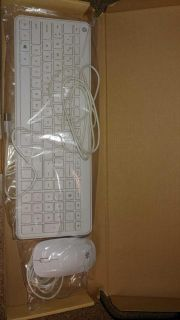 HP white keyboard and mouse.