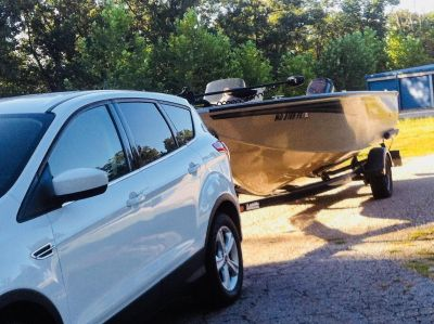 2004 17.5 ft Lowe fishing machine boat, 90 horse outboard, and trailer