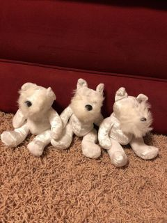 Three - 6 tall white dogs all 3 for $3.00
