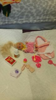 Vintage barbie baby with many acessories.