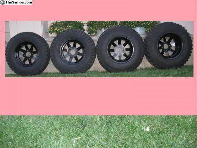 4 Lug Black steel wheels w/ offroad desert tires