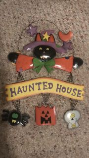 15x11 Haunted House tin sign $1