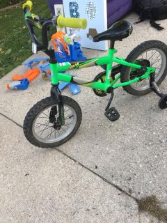 Boys 14 bike with training wheels. Seat is ripped and needs new back tire. We have a new one just needs to be put on.