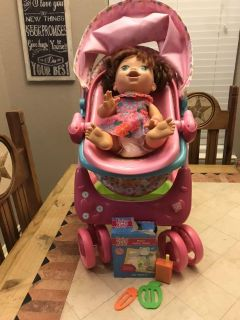 Baby Alive doll with accessories & stroller