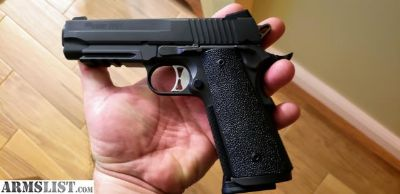 For Sale/Trade: brand new Sig Sauer 1911 Tac Ops in 4 inch with a rail and night sites.
