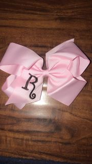 Brand new never worn monogram R light pink bow