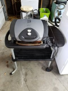 Lean mean fat reducing grilling machine with stand