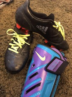Adidas soccer cleats size 7 1/2 mens and nike shin guards size L.