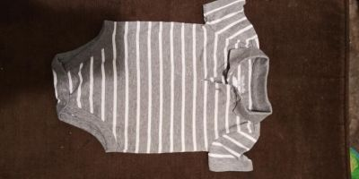 6 to 9 month collared onesie gray and white striped. Excellent condition no stains or tears