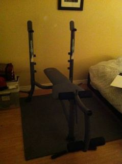 Weight bench with bar and leg curl