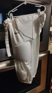 Nike Boy's Size XL football pants w pads in excellent condition, also available in black