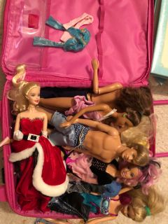 Multiple barbies and clothes with case