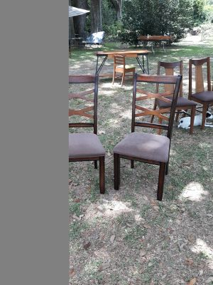 Two solid wood chairs with