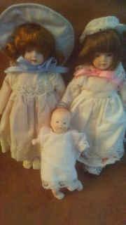3 porcelain dolls. All dressed. 1 baby that is 5 inches and 2 girls that are 8 inches. Very good condition!