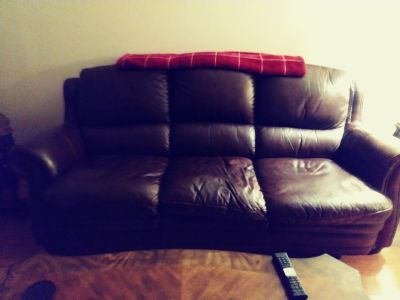Real leather couch and loveseat. PLEASE READ COMES WITH ACCESSORIES