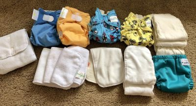 Newborn to 3 months, cloth diaper lot. Some pockets, some all in ones, and some all in twos! All perfect condition or new! No stains!