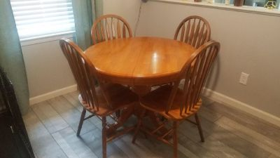 Dining table with hidden leaf and 4 chairs