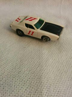 AFX. #11 H. O. Scale slot car in good condition