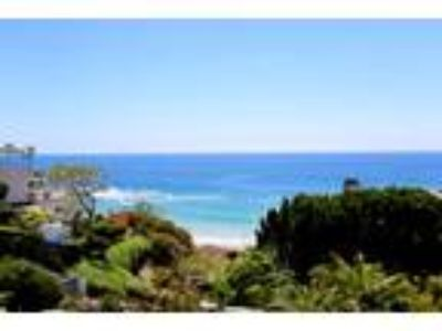 VIEW, LOCATION AND STYLE! This beautiful Four BR home offers ocean views f...