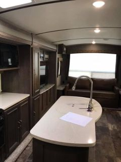 Couch from Keystone Elite by Passport Travel Trailer