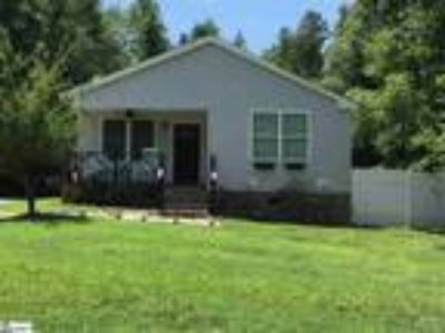 This cozy Two BR, Two BA ranch home is loo...