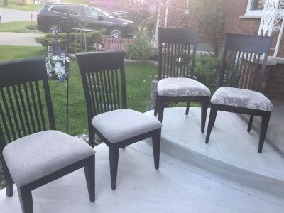 4 solid dining room chairs, 2 different fabrics. Comfy thick cushions. Delivery available
