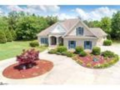 Rare find country oasis with almost 3 acres! ...