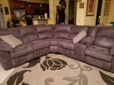 gray sectional couch with reclining ends