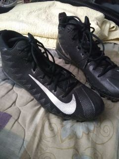 Football cleats,pads and under armor shirt