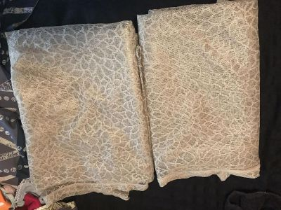 Set of two tan lace curtains about 5 feet long