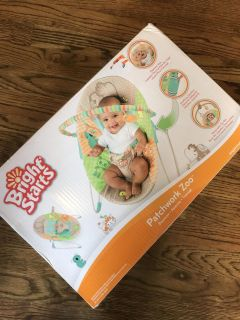 Brand new never used Bright Starts baby bouncer.