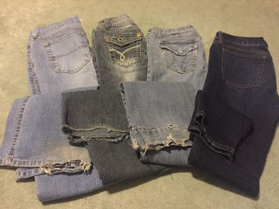 4 pairs of size 3 jeans