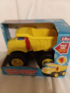 Fun Stuff Light and Sound Dump Truck new in package 18 months and older